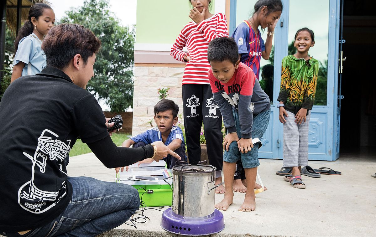 People using the ACE1 Cookstove