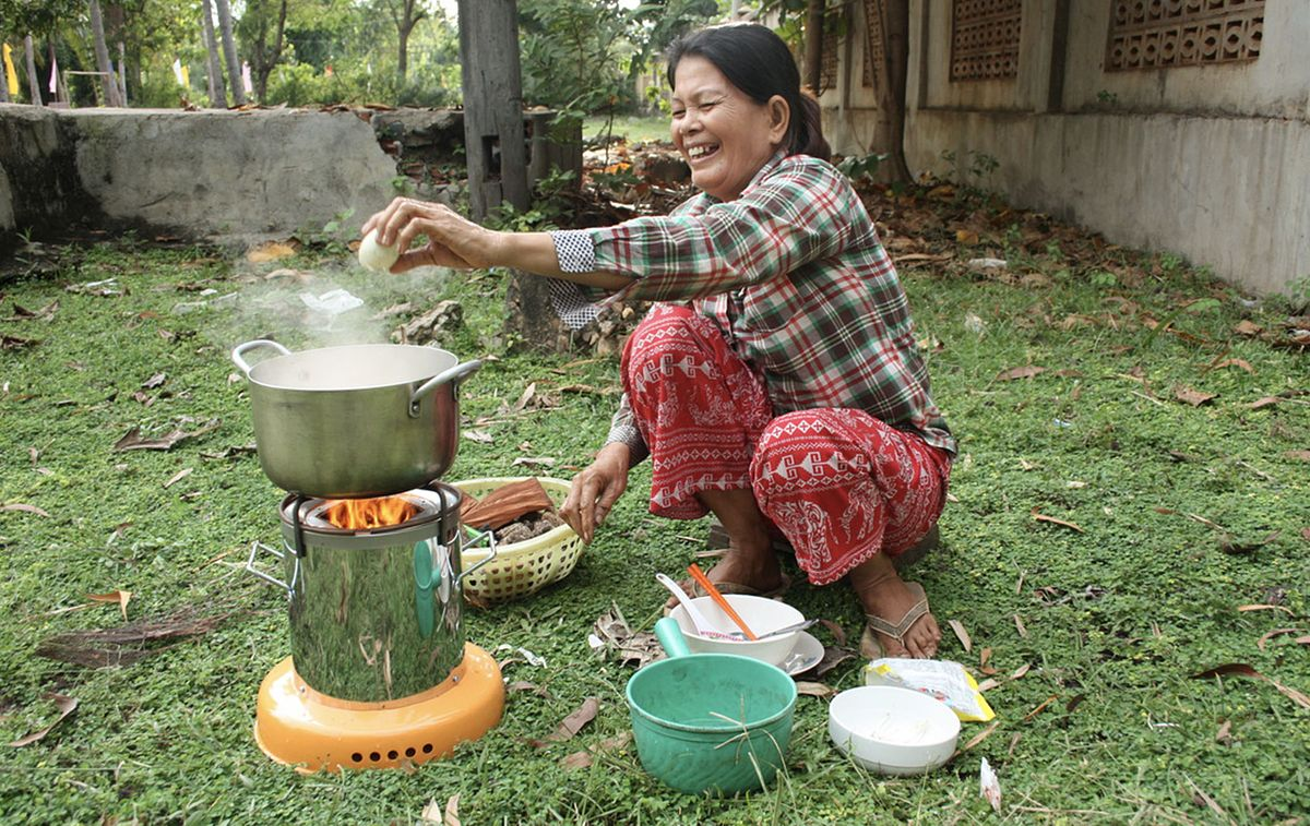 ACE customer using the cookstove in Cambodia